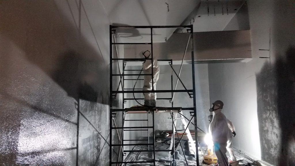 concrete waterproofing calgary - working on steel structure